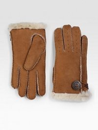 Keep your hands warm in this perforated shearling sheepskin design in soft suede or supple leather with button loop detail. About 8½ long Imported Fur origin: Spain