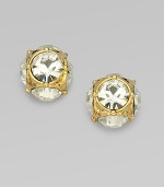 Sparkling glass studs gleam from under a delicate, golden pattern. Glass 12k goldplated Diameter, about ½ 14k gold-filled post back Imported