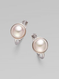 Glistening mabe pearl faceted in sterling silver makes for a timeless design. 10mm mabe pearl Sterling silver Drop, about ½ Ear wire back Made in Spain