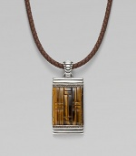 A stunning dogtag pendant is designed in fine silver with basketwoven tiger's eye and quartz detail on a leather cord necklace. From the Bedeg Collection Silver Tiger's eye Quartz, 0.56 tcw Leather Pendant, 1W X 2¼H Necklace, adjustable 18-20 Lobster clasp Imported