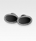 Sleek, smooth onyx stones are set into finely engraved sterling silver. About 1 X ½ Made in USA