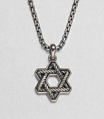The familiar angles of the Star of David are intricately carved, set in polished sterling silver on a box-chain necklace.Sterling silverbulletNecklace, about 20 longPendant, about 1 wideLobster claspImported