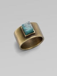 A structural piece with a square, center turquoise stone. TurquoiseBrassWidth, about ½Made in USA