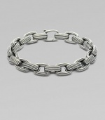 A handsome linked design, intricately textured in sterling silver. From the Royal Cord Collection Sterling silver Clasp closure About 8½ long Imported