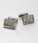 Polished, rectangular shaped cuff links set in mixture of brass and stainless steel, enhanced by a three-level etching design.Brass/stainless steelAbout ½ x ¼Imported
