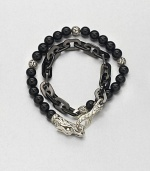Double-strand beaded and link bracelet of sterling silver and black onyx is offset by an engraved lobster clasp.Sterling silver/stainless steelBlack onyxAbout 3 diam.Imported