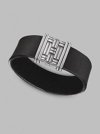 A handsome combination of leather and silver with a basketwoven silver clasp. From the Bedeg Collection Leather Silver Magnetic pusher clasp About 7½ long Imported