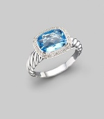 From the Noblesse collection. A glimmering blue topaz, surrounded by diamonds, balances elegantly on a cable band of sterling silver. Diamonds, 0.21 tcw Blue topaz Sterling silver Imported