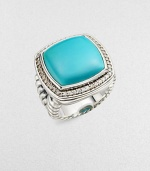 From the Albion Collection. A classic Yurman design, offering a smooth cushion of brilliant turquoise, framed in diamonds, on a split cable band of sterling silver.Diamonds, 0.48 tcw Turquoise Sterling silver About 1 square Imported