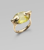 From the Lollidrops Collection. A modern take on the cocktail ring, offering a large oval of faceted quartz in a grommeted setting of 18k yellow gold. Lemon quartz 18k yellow gold Length, about 1 Made in USA