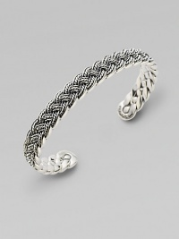 A bold accent crafted in sterling silver with a woven design that lends immediate texture. Sterling silver0.375 wideImported