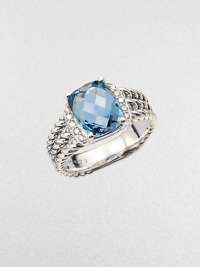 From the Petite Wheaton Collection. A stunning, faceted blue topaz stone flanked by brilliant diamonds on a sterling silver, triple-row shank. Blue topazDiamonds, .1 tcwSterling silverImported