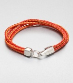 Boldly-hued, braided strands of fine leather are offset by a sterling silver clasp.LeatherSterling silverAbout 2½ diam.Made in the United Kingdom