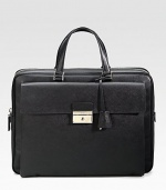 An elegant briefcase in textured saffiano leather with a large envelope exterior pocket. Zip closure Top handles Exterior pocket with clasp closure Interior zip pocket 15¾W X 12H X 2¼D Made in Italy