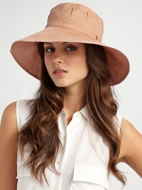 Wide brim cotton organdy with pleated crown and split back brim is perfect for travel or a day at the beach.Adjustable drawstring ties One size fits most Brim, about 4 wide Cotton; dry clean Imported
