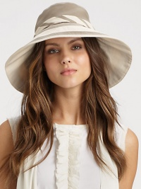 This colorblocked, yet neutral design features an external, adjustable tie and removable inner band. CottonBrim, about 4¼Removable inner bandCotton linedHand washImported