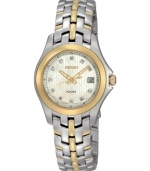 Decadent design, by Seiko. This watch features a goldtone and silvertone stainless steel bracelet and round case, 13mm. Goldtone bezel. Mother-of-pearl dial with logo, date window and diamond accents at indices. Analog quartz movement. Water resistant to 100 meters. Three-year limited warranty.