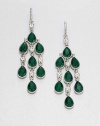 From the Emerald City Collection. Faceted teardrops in emerald green, punctuated by tiny clear stones to create delicious dazzle.Glass and plasticSilvertoneLength, about 3.25Ear wireImported