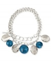 Eclectic elegance. Kenneth Cole New York's half stretch bracelet, crafted from silver-tone mixed metal, brings together blue glitter and faceted oval beads to stunning effect. Item comes packaged in a signature Kenneth Cole New York Gift Box. Approximate diameter: 2-1/2 inches.