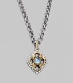 Chic little blossom accent in gleaming sterling silver and 18k gold, centered with a smooth cabochon blue topaz stone. Chain sold separately About ½W X ¾H Imported