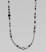 From the Quatrefoil Collection. An extra long sterling silver chain with bead and quatrefoil stations.Black onyx & hematite Sterling silver Can be worn doubled Length, about 48 Lobster clasp closure Imported