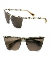 A modified square style in sleek metal accented in luxurious snakeskin-print leather and glittering Swarovski crystals. Available in silver/black with smoke gradient lens. Snakeskin-print leather temples and brow barSwarovski crystals100% UV protectionMade in Italy