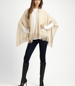 A casual style with an open drape front, warm hood and pretty fringe details in luxurious cashmere. HoodedOpen, draped frontPull-over styleFringed hemAbout 28 from back shoulder to hemCashmereDry cleanImported