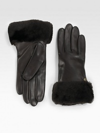A soft, dyed shearling cuff and luxurious cashmere lining help make this leather style a cold weather essential. About 9 longSpecialist dry cleanImportedFur origin: Spain