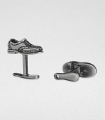 If the shoe fits, wear it on your sleeve with these sterling silver and black rhodium cuff links.Sterling silverShoe horn-shaped backAbout .87 diam.Made in USA
