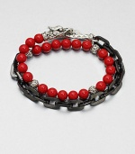This chain link and beaded, multi-row design of stainless steel and sterling silver is embellished with red coral for a colorful, charismatic touch.Stainless steel/sterling silverCoralAbout 3 diam.Imported