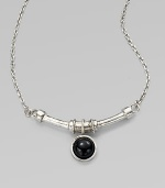 A single, glossy dome of black agate on a curved bar and a link chain. SilvertoneBlack agateLength, about 18Pendant size, about ½Lobster clasp closureMade in USA
