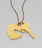 Show everyone the key to your heart with this sweet, double pendant design on a link chain. Goldtone brassLength, about 10.6Pendant size, about 1Lobster clasp closureMade in Italy
