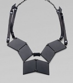 Pieced together diamond-shape brass plaques and strips of rich Italian leather come together in this street-smart, edgy design.Black, powder-coated brassLeatherHematite finish chainLength, about 19Lobster claspMade in USA