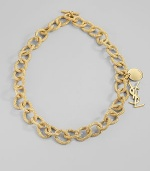 Bold, textured golded links are accented with two YSL logo charms. Goldtone Length, about 13 Toggle closure Made in Italy