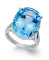Richly colored with plenty of sparkle, this fun, bright ring features a dramatic oval-cut blue topaz (21-9/10 ct. t.w.) set in sterling silver. Size 7.