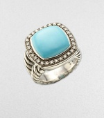 From the Moonlight Ice Collection. A beautiful turquoise center stone surrounded by dazzling diamonds sits atop a cable ring. Diamonds, .45 tcw Turquoise Blackened sterling silver Width, about ½ Imported
