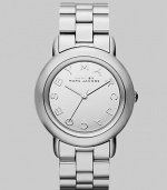 Smart and chic style with a mirror dial for added shine. Quartz movement Water resistant to 5 ATM Round stainless steel case, 36mm (1.4) Silver mirror logo dial Second hand Stainless steel link bracelet, 18mm wide (0.7) Imported