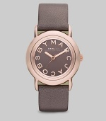 Smart and chic style with leather strap. Quartz movement Water resistant to 5 ATM Round ion-plated rose gold stainless steel case, 33mm (1.3) Gray mirror logo dial Second hand Metallic gray leather strap, 18mm wide (0.7) Imported