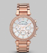 This warm rose gold timepiece shines with a crystal bezel. Quartz movement Water resistant to 5 ATM Round rose goldplated stainless steel case, 39mm (1.5) Crystal bezel Mother-of-pearl dial Arabic numeral and bar hour markers Second hand Rose goldplated stainless steel link bracelet Imported