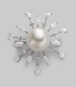 A shiny starburst with lustrous pearl center radiates with glimmering rhinestone rays. 14mm round white pearl Cubic zirconia Sterling silver Diameter, about 1½ Pin backing Made in Spain