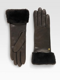 Durable deerskin leather accented with luxurious cashmere lining and shearling sheepskin cuff.Metal logo detailAbout 11 longSpecialist dry cleanImportedFur origin: Spain