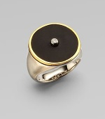 From the Nile Collection. A dramatic disc of black onyx is centered with one sparkling white topaz, framed in gleaming goldplate and set atop a brushed sterling silver band.Black onyx and white topazSterling silverGoldplatedDiameter, about ¾Imported