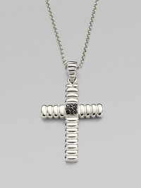 A polished cross pendant is suspended from a chain necklace, both crafted in sterling silver.From the Bedeg CollectionSterling silverPendant, 1¼W x 1½HNecklace, 24 lengthImported