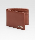 Modern classic bifold design features front logo plaque detail, three credit crad slots and one ID slot set in luxuriously soft leather.One billfoldThree card slotsOne clear identification windowLeather4W x 4H x 1DImported