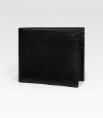 Saffiano leather wallet opens to eight credit card slots and two billfold compartments. Embossed Prada logo detail 4¼W X 3¾H Made in Italy