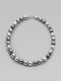 A soft melange of grey, nuage and white baroque man-made pearls creates drama at the neck. 14mm multicolor organic baroque pearls Length, about 20 Sterling silver spring clip clasp Made in Spain
