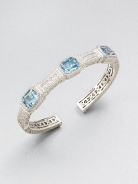 A highly intricate design with three emerald-cut blue topaz stones. Blue topazRhodium-plated sterling silverDiameter, about 2.25Slip-on styleImported