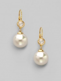 A perfectly round sphere of white organic pearl, sparkling stud and 18k gold vermeil for a look of timeless elegance.12mm round white pearls Cubic zirconia 18k gold vermeil Drop, about 1½ Ear wire Made in Spain