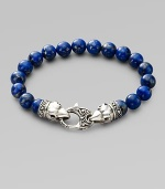 A welcome touch of color, strung with 10mm lapis beads and a raven's head sterling silver clasp. About 9¼ long Imported