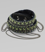 An edgy, street-smart design with oxidized links brightly stitched onto a double-wrap leather cuff with draped chains and a bold stud closure.LeatherGoldtoneCotton backingLength, about 16½Width, about 3Stud snap closureImported